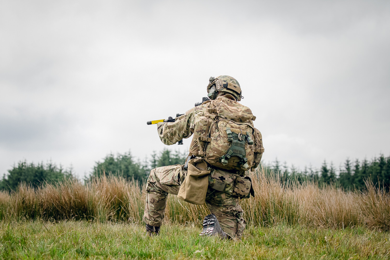 Crouching UK Army soldier on patrol wearing virtus MTP