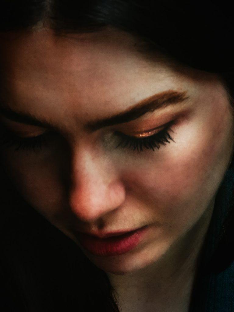 Remote portrait of a girl looking down taken by Pixellit Commercial Photography